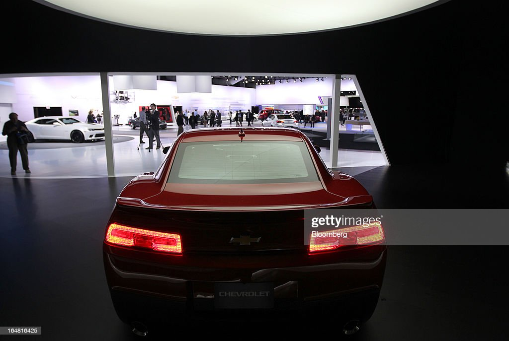 The Chevrolet 2014 Camaro vehicle sits on display at the company's booth during the 2013 New York International Auto Show in New York, U.S., on Thursday, March 28, 2013. The 113th New York International Auto Show, which runs from March 29 to April 7, features 1,000 vehicles as well the latest in tech, safety and innovation. Photographer: Jin Lee/Bloomberg via Getty Images