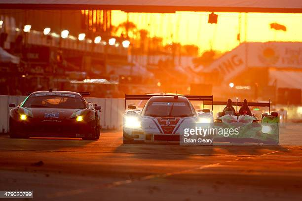 The Chevrolet Corvette DP of Joao Barbosa Christian Fittipaldi and Sebastien Bourdais is shown in action at sunset during the 12 Hours of Sebring at...