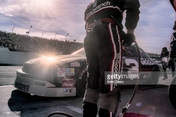 The Chevrolet of Dale Earnhardt makes a pit stop during the Atlanta Journal 500 NASCAR Winston Cup race Atlanta Motor Speedway on November 18 1990 in...
