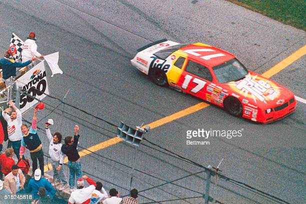 The Chevrolet of Darrell Waltrip crosses the finish line and gets the checkered flag to win the Daytona 500