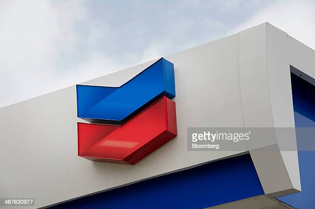 The Chevron Corp logo is displayed at one of the company's fueling stations in Richmond California US on Thursday April 24 2014 Chevron Corp is...
