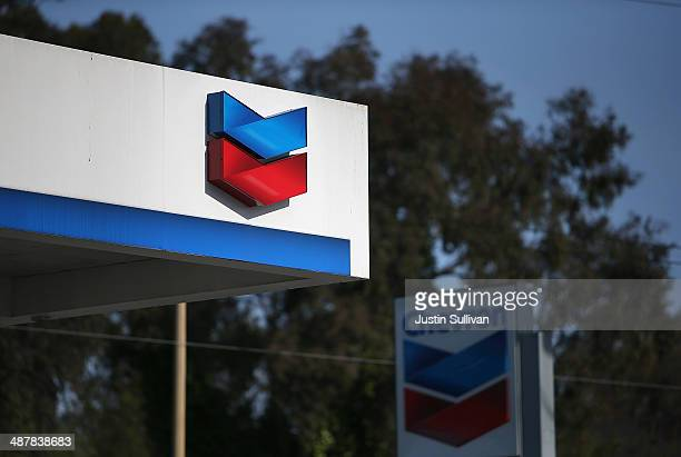The Chevron logo is displayed at a Chevron gas station on May 2 2014 in San Francisco California Chevron Corp reported a 27 percent plunge in first...