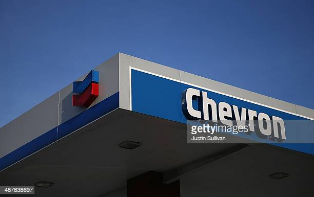 The Chevron logo is displayed at a Chevron gas station on May 2 2014 in Greenbrae California Chevron Corp reported a 27 percent plunge in first...
