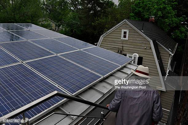 The Chevy Chase home of John Murphy and Marcie Deditch features solar panels Cover story for the Real Estate section on the home that architects John...
