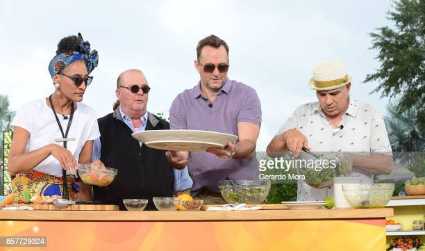 'The Chew' cohosts Carla Hall Mario Batali Clinton Kelly and Michael Symon broadcasts from the 22nd Epcot International Food Wine Festival at Epcot...