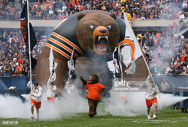 """The Chicago Bear mascot, """"Staley,"""" runs onto the field during player introductions before a game against the Cleveland Browns at Soldier Field on..."""