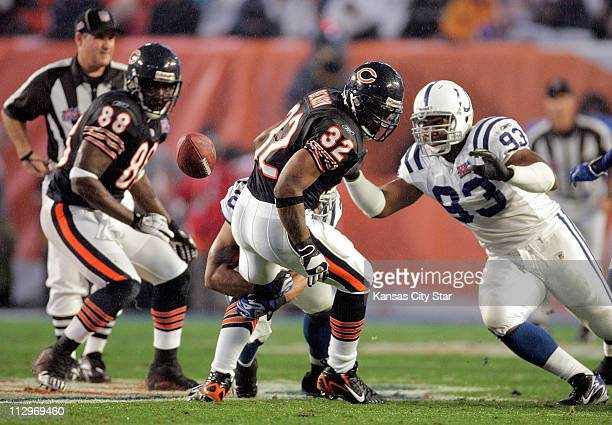 The Chicago Bears Cedric Benson loses the ball against the Indianapolis Colts in Super Bowl XLI in Miami, Florida, on Sunday, February 4, 2007.