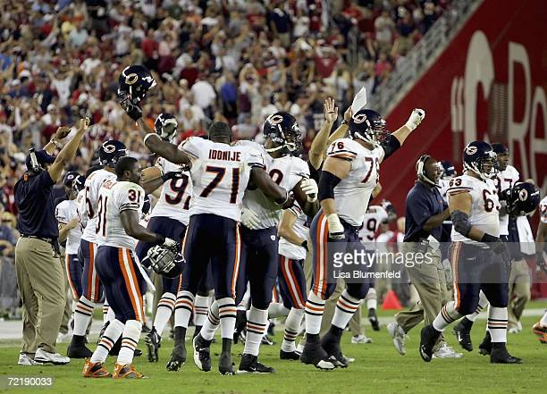 The Chicago Bears celebrate after Neil Rackers of the Arizona Cardinals misses a field goal attempt in the final seconds of the game on October 16...