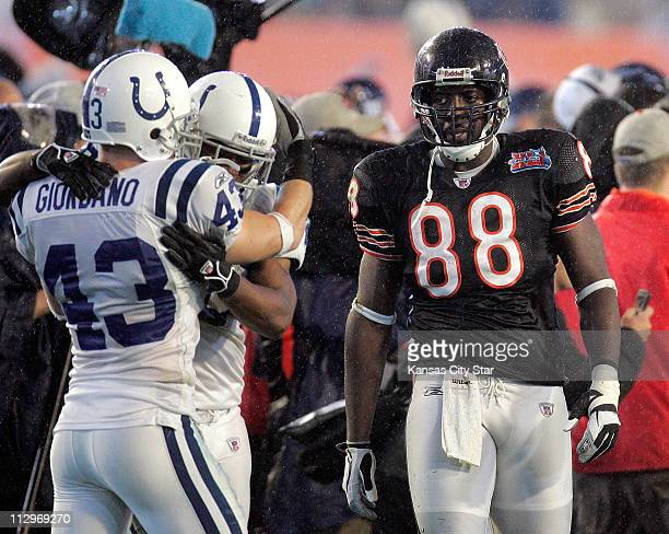 The Chicago Bears' Desmond Clark walks off the field as the Indianapolis Colts begin to celebrate a 29-17 victory over the Chicago Bears in Super...