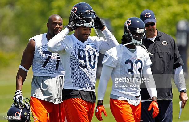 The Chicago Bears' Israel Idonije Julius Peppers and Charles Tillman and offensive coordinator Mike Tice at the team's OTA at Halas Hall in Lake...