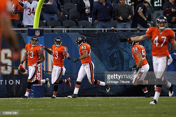 The Chicago Bears' Johnny Knox is greeted by his teammates after running a punt return in for a touchdown in the fourth quarter against the Green Bay...
