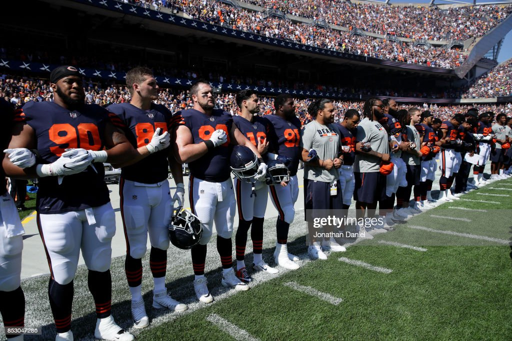 The Chicago Bears lock arms for the national anthem prior to the game against the Pittsburgh Steelers at Soldier Field on September 24, 2017 in Chicago, Illinois.