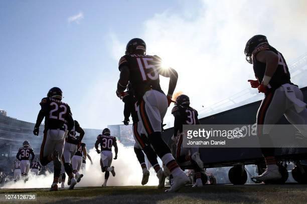 The Chicago Bears run onto the field at the start of the game against the Green Bay Packers at Soldier Field on December 16 2018 in Chicago Illinois