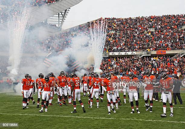 The Chicago Bears run onto the field during player introductions before a game against the Cleveland Browns at Soldier Field on November 1 2009 in...