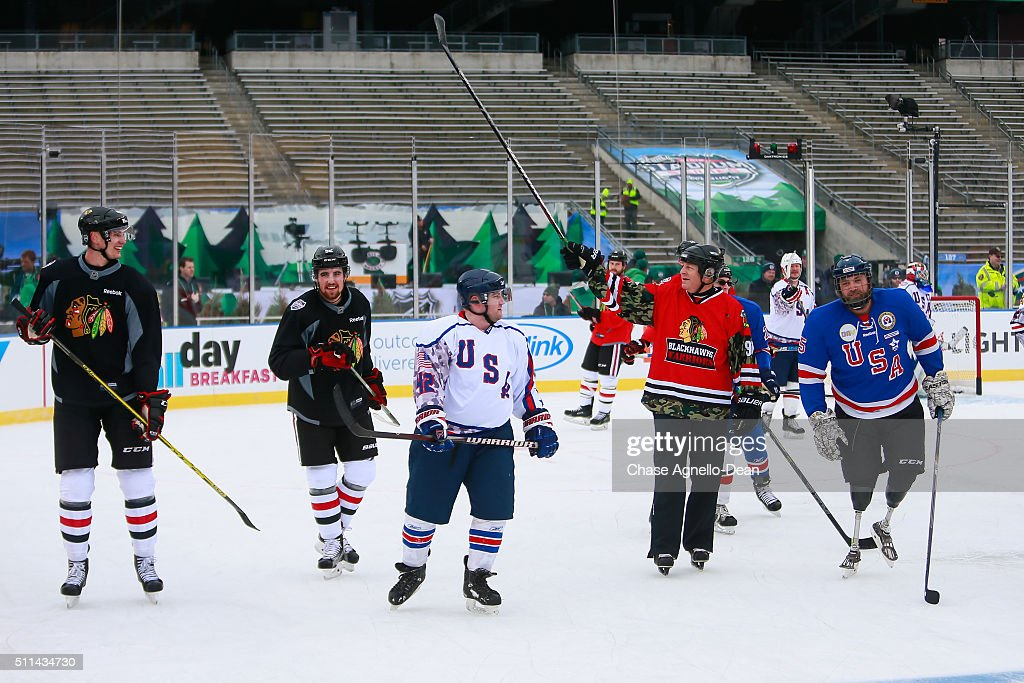The Chicago Blackhawks and the Wounded Warriors hockey team skate during practice day for the 2016 Coors Light Stadium Series game against the Minnesota Wild at TCF Bank Stadium on February 20, 2016 in Minneapolis, Minnesota.