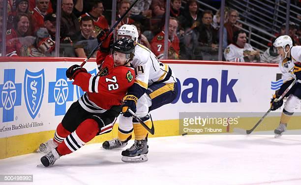 The Chicago Blackhawks' Artemi Panarin battles the Nashville Predators' Mattias Ekholm in the first period at the United Center in Chicago on Tuesday...