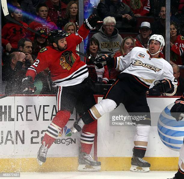 The Chicago Blackhawks' Brandon Bollig left and the Anaheim Ducks' Francois Beauchemin collide in the first period on Friday Jan 17 at the United...