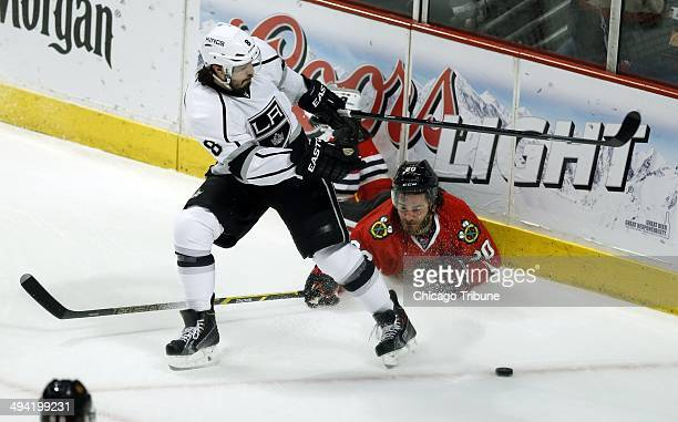 The Chicago Blackhawks' Brandon Saad right tries to get the puck away from the Los Angeles Kings' Drew Doughty in the first period in Game 5 of the...