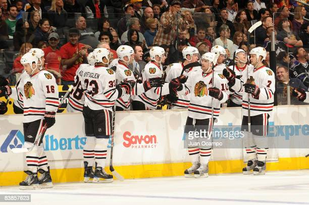 The Chicago Blackhawks celebrate a first period goal from teammate Patrick Sharp against the Los Angeles Kings during the game on November 29, 2008...