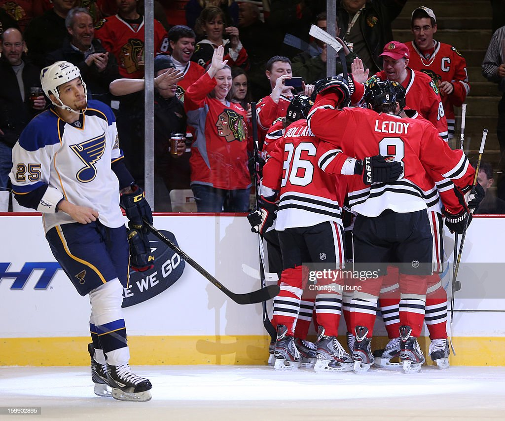 The Chicago Blackhawks celebrate a goal by Patrick Kane in the first period against the St. Louis Blues at the United Center in Chicago, Illinois, on Tuesday, January 22, 2013.