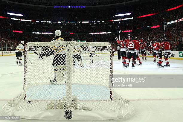 The Chicago Blackhawks celebrate after Andrew Shaw scored the game-winnning goal in the third overtime against the Boston Bruins in Game One of the...