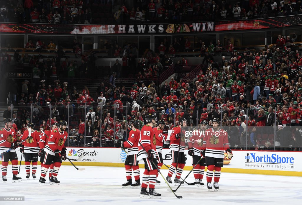 The Chicago Blackhawks celebrate after defeating the Boston Bruins 3-1 at the United Center on March 11, 2018 in Chicago, Illinois.