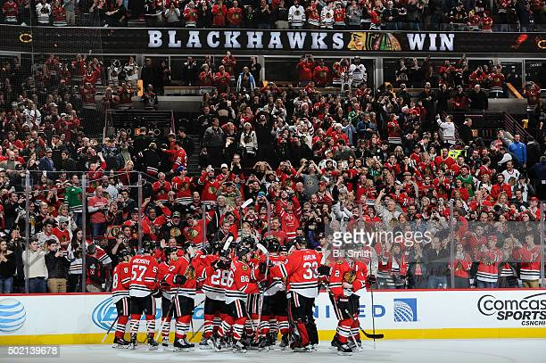 The Chicago Blackhawks celebrate after defeating the San Jose Sharks 4 to 3 in overtime during the NHL game at the United Center on December 20 2015...