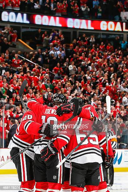 The Chicago Blackhawks celebrate after scoring against the Los Angeles Kings in the second period during the NHL game at the United Center on March...