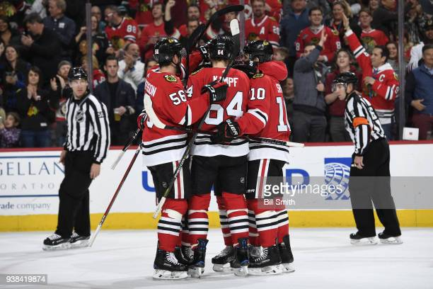 The Chicago Blackhawks celebrate after scoring against the San Jose Sharks in the first period at the United Center on March 26 2018 in Chicago...