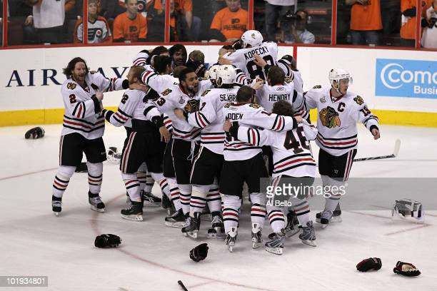 The Chicago Blackhawks celebrate after teammate Patrick Kane scored the gamewinning goal in overtime to defeat the Philadelphia Flyers 43 and win the...