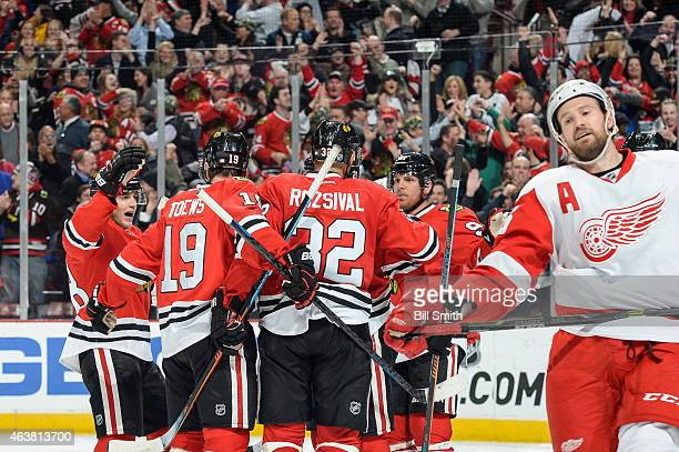 The Chicago Blackhawks celebrate behind Niklas Kronwall of the Detroit Red Wings including Patrick Kane and Brad Richards after scoring in the third...