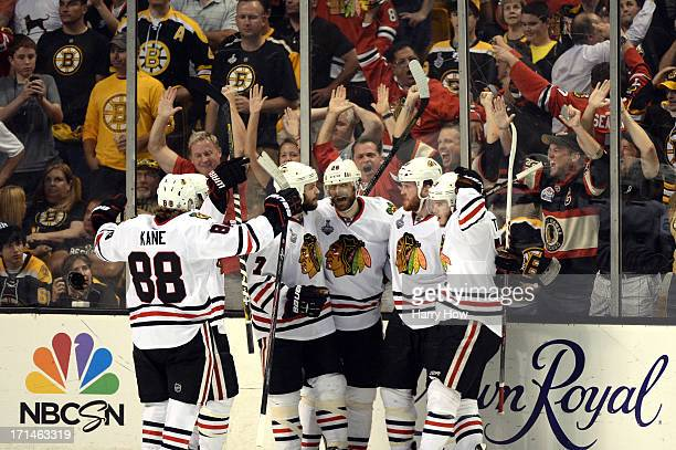 The Chicago Blackhawks celebrate defeating the Boston Bruins in Game Six of the 2013 NHL Stanley Cup Final at TD Garden on June 24 2013 in Boston...