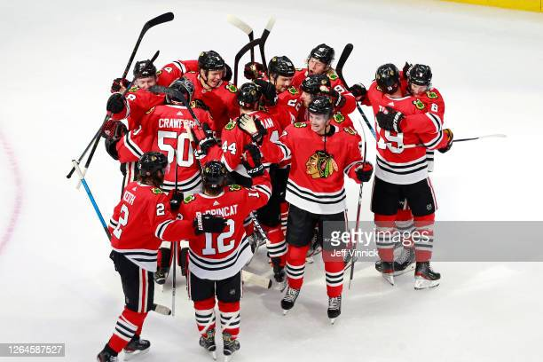 The Chicago Blackhawks celebrate their 3-2 victory against the Edmonton Oilers to win Game Four and the Western Conference Qualification Round prior...