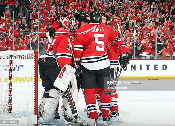 The Chicago Blackhawks celebrate their 74 win with goaltender Antti Niemi after Game Five of the 2010 NHL Stanley Cup Finals against the Philadelphia...