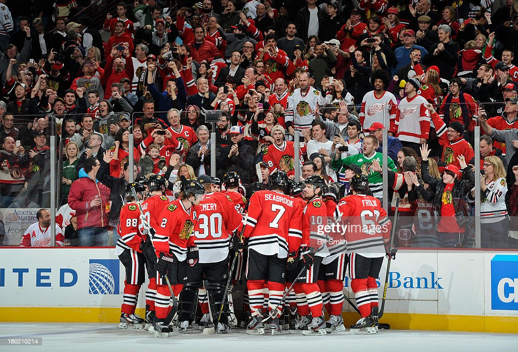 The Chicago Blackhawks celebrate their overtime win against the Detroit Red Wings on January 27, 2013 at the United Center in Chicago, Illinois.