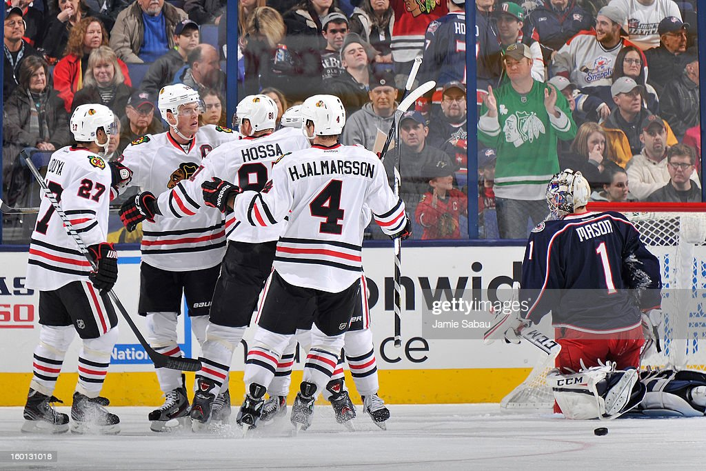 The Chicago Blackhawks celebrate with Jonathan Toews #19 of the Chicago Blackhawks after Toews' third period goal on goaltender Steve Mason #1 of the Columbus Blue Jackets on January 26, 2013 at Nationwide Arena in Columbus, Ohio. Chicago defeated Columbus 3-2 to start the season 5-0 for the first time in team history.