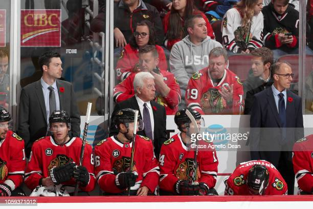 The Chicago Blackhawks coaching staff head coach Jeremy Colliton assistant coaches Barry Smith and Don Granato watch the action against the Carolina...