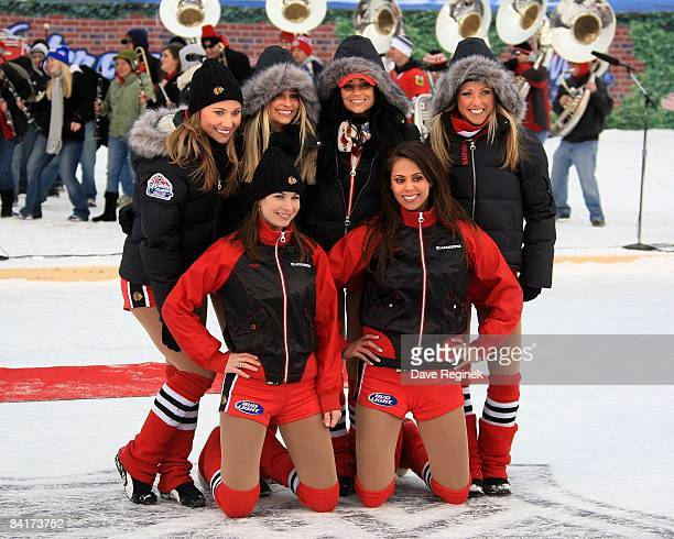 The Chicago Blackhawks ice crew girls pose for a picture during the NHL Winter Classic hockey game against the Detroit Red Wings on January 1 2009 at...