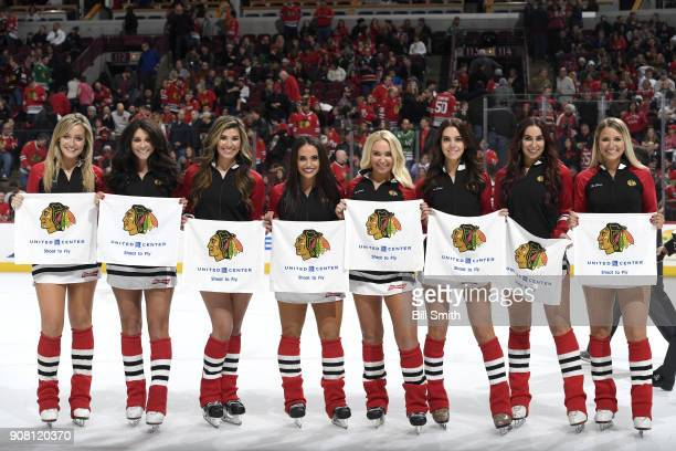 The Chicago Blackhawks ice crew pose for a photo during the game between the Chicago Blackhawks and the New York Islanders at the United Center on...