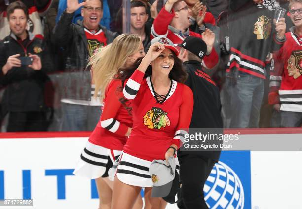 The Chicago Blackhawks icecrew pick up hats after a hattrick by Artem Anisimov in the third period against the New York Rangers at the United Center...
