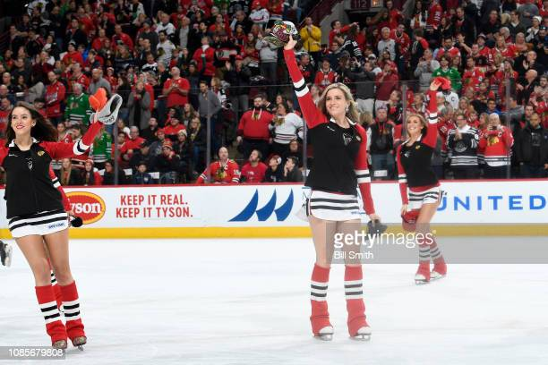 The Chicago Blackhawks icecrew pick up hats after Jonathan Toews of the Chicago Blackhawks scored a hattrick in the third period against the...