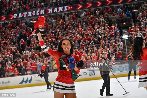 The Chicago Blackhawks icecrew pick up hats after Patrick Kane scored a hattrick against the Boston Bruins in the second period of the NHL game at...