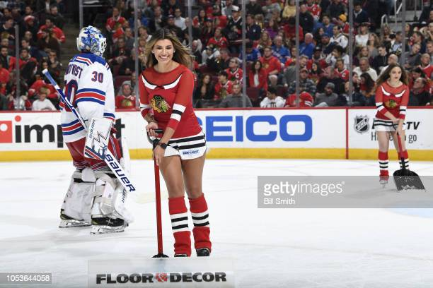 The Chicago Blackhawks icecrew scrape the ice in the third period between the Chicago Blackhawks and the New York Rangers at the United Center on...