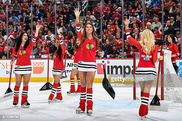 The Chicago Blackhawks icecrew wave to the crowd during the game between the Chicago Blackhawks and the Toronto Maple Leafs at the United Center on...