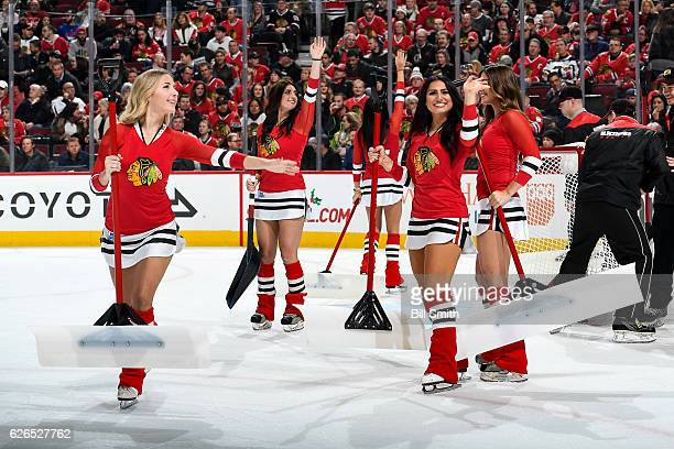 The Chicago Blackhawks icecrew wave to the crowd during the game against the Florida Panthers at the United Center on November 29 2016 in Chicago...