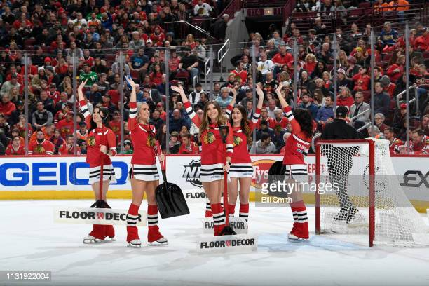 The Chicago Blackhawks icecrew wave to the crowd in the first period between the Chicago Blackhawks and the Philadelphia Flyers at the United Center...