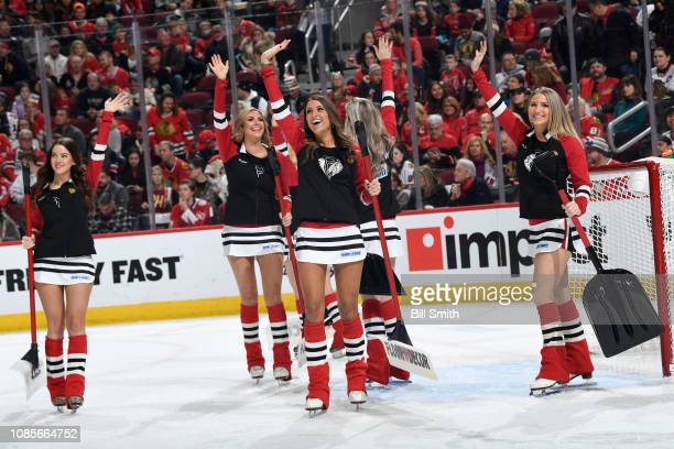The Chicago Blackhawks icecrew waves to the crowd during the game between the Chicago Blackhawks and the Washington Capitals at the United Center on...