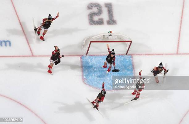 The Chicago Blackhawks icecrew waves to the crowd during the game between the Chicago Blackhawks and the Vancouver Canucks at the United Center on...