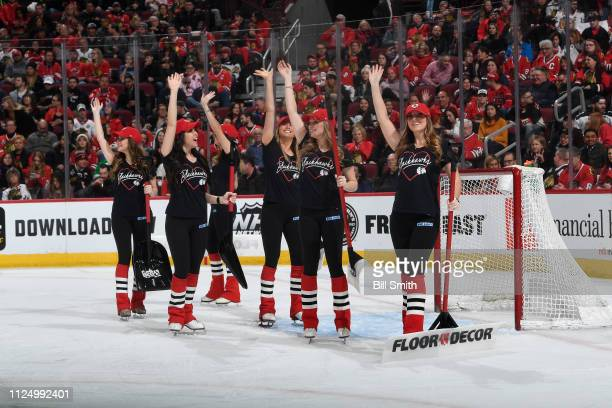The Chicago Blackhawks icecrew waves to the crowd during the game between the Chicago Blackhawks and the New Jersey Devils at the United Center on...