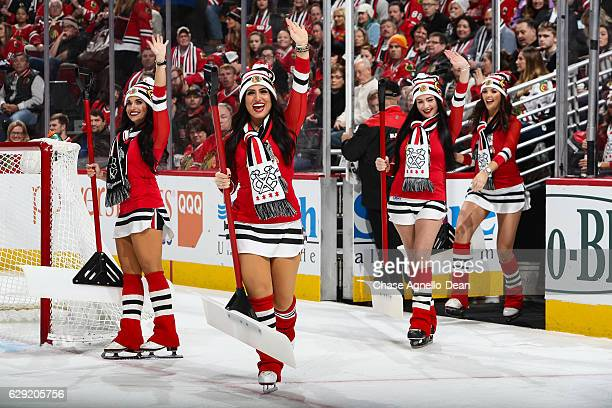 The Chicago Blackhawks icecrew waves to the crowd during the game between the Chicago Blackhawks and the Dallas Stars at the United Center on...